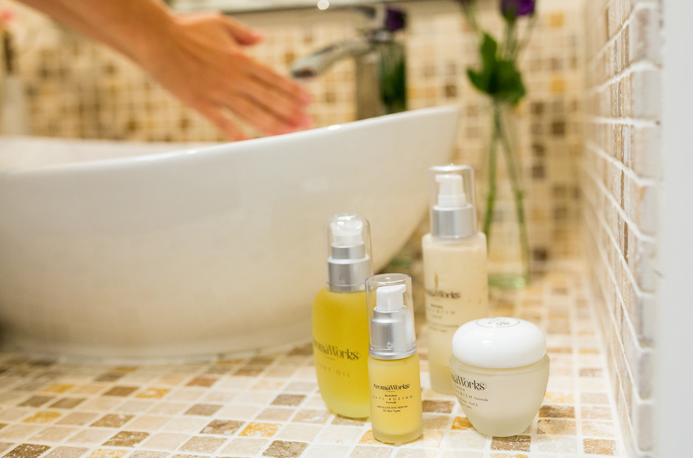 aromaworks beauty products near tiled sink