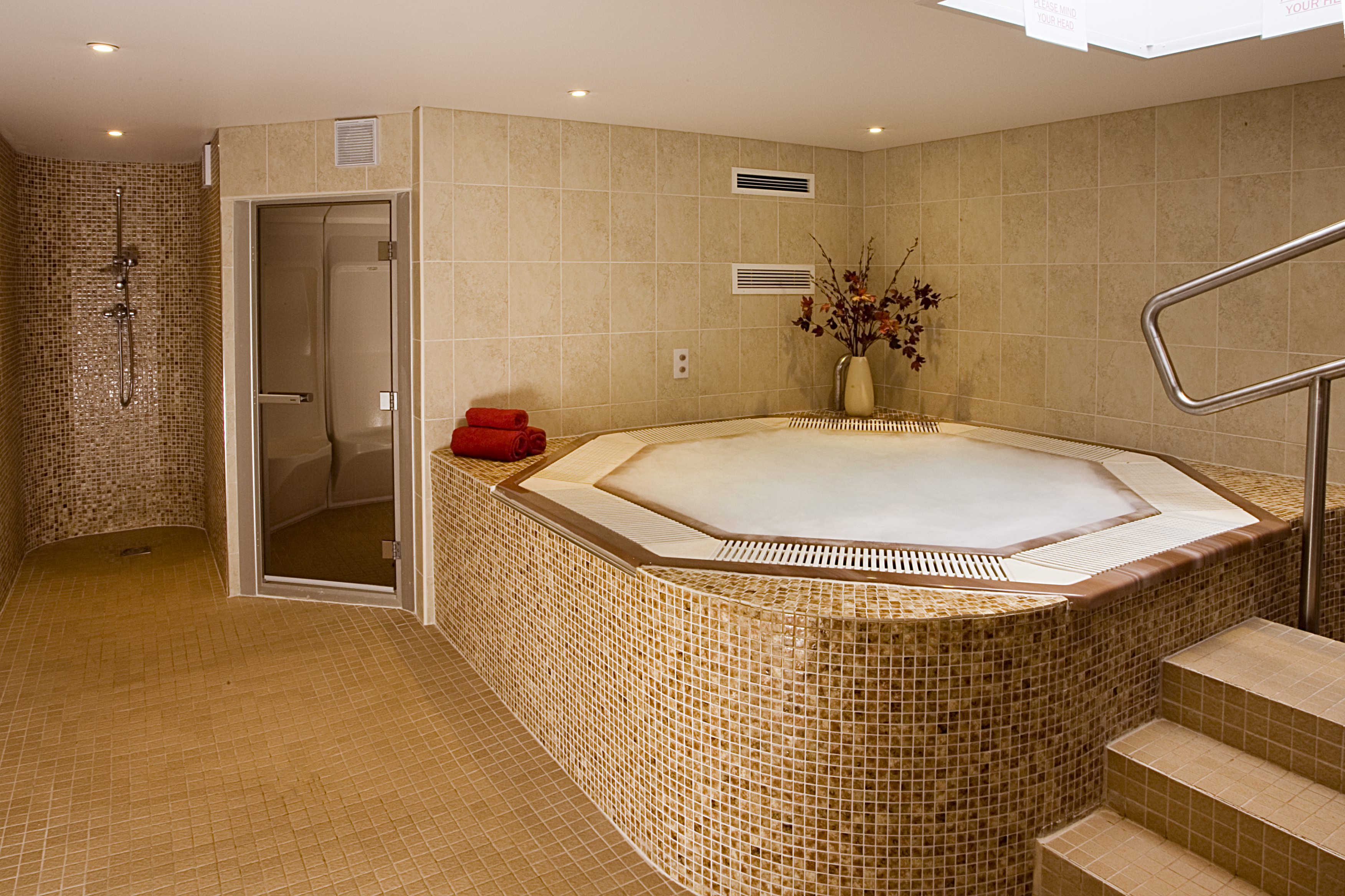 luxury brown tiled spa with jacuzzi