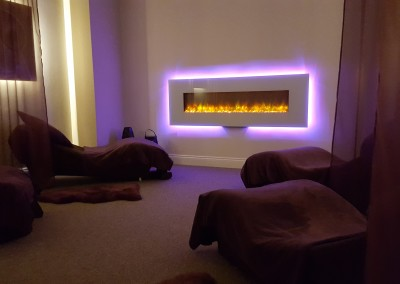relaxing electric fire in relaxation room with purple neon light around it