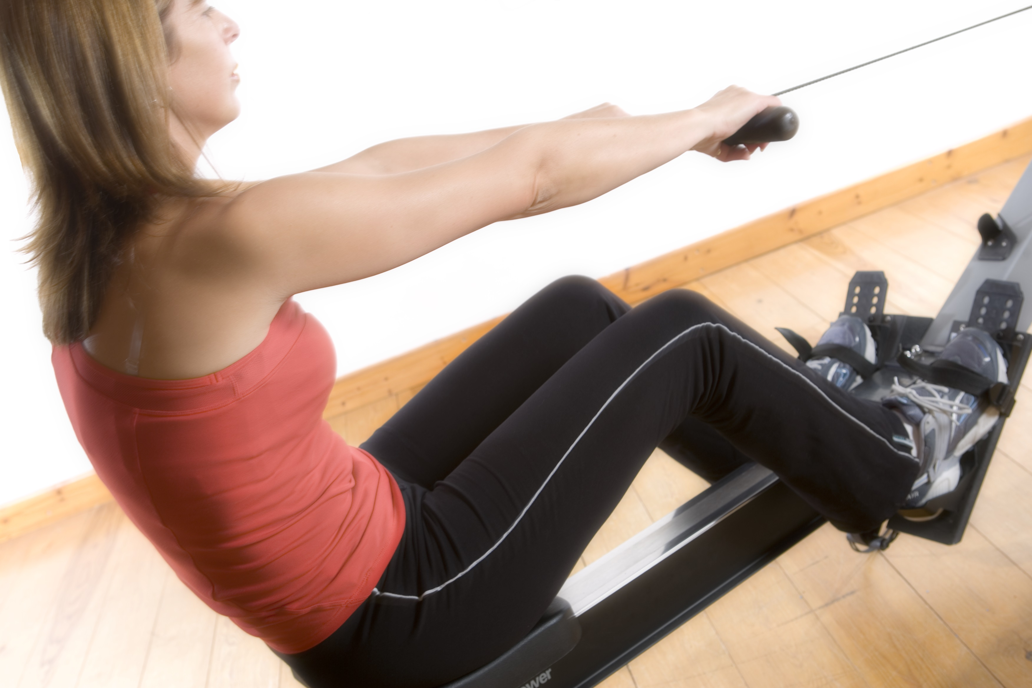 lady on rowing machine working on cardiovascular fitness