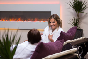 two ladies laughing in a beautiful relaxation room on a spa break