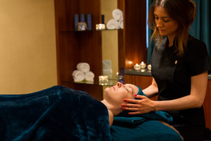 spa day guest enjoying luxury facial in treatment room